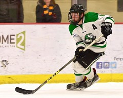 Speed and Intensity (R.A. Killmer) Tags: acha skate skater speed ice hockey green white college edges puck slippery rock