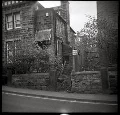 Old House on Monk Bridge Road (Saturated Imagery) Tags: blackandwhite house 120 film mediumformat square iso400 toycamera grain ilford selfdeveloped plasticlens meanwood kodaktrix400 dianadeluxe microphen epsonv500 photon120 monkbridgeroad filmdev:recipe=7536