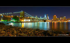 Brooklyn Bridge At Night (Kit Downey) Tags: new york city nyc bridge blue color skyline brooklyn night skyscraper canon reflections river lens eos rebel lights long exposure colours angle dusk manhattan wide may east tokina explore shore single hour kit iconic f28 2012 downey explored 550d t2i 1116mm