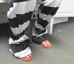 that should keep her from running away (Inmate_Stripes) Tags: woman white black female chains stripes prison jail shackles handcuffs prisoner inmate