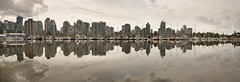 Vancouver BC Waterfront Skyline from Stanley Park (JPLPhotographyPDX) Tags: park city travel sky panorama house canada reflection water rain skyline club vancouver buildings harbor living boat downtown cityscape bc waterfront cloudy property columbia stanley british recreation yachts condos condominiums