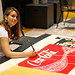 "Ariana Frascatore works on painting the Times Square Jumbotron for the set of Potsdam High School's performance of ""A Night on Broadway,"" Friday, May 31 at 8 pm in the high school auditorium."