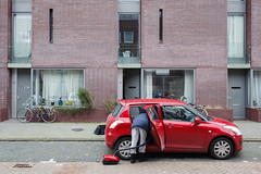 (Peter de Krom) Tags: red car lady utrecht vacuum cleaning cleaner vacuuming stadsschouwburg commissioned