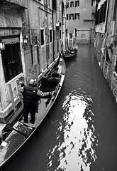 Gondolas (Brendan David Hughes) Tags: venice blackandwhite italy man photography sharp gondola
