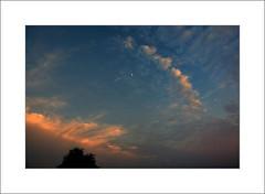 Half Moon Waiting (David in NC) Tags: sunset moon clouds half