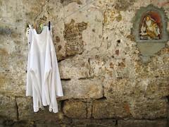 (Monica Forss) Tags: italy wall italia madonna laundry sicily palermo sicilia canonixus75