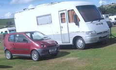 Little and Large (occama) Tags: uk camping red car site cornwall fiat small 1999 class 400 1998 caravan motorhome tow microcar sans aixam vehicule permis ducato t57bhy