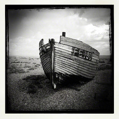 FE180 (Jon Downs) Tags: old uk sea sky cloud white black art beach clouds vintage downs square photography boat photo seaside jon flickr artist photographer image 5 decay shingle picture pic photograph dungeness iphone fe180 iphone5 hipstamatic jondowns