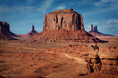8600 Monument Valley Utah ~ A man and his horse (Bettina Woolbright) Tags: red arizona sky horse orange southwest texture monument rock utah butte indian september valley layers navajo monumentvalley pinnacle merrick horseandrider horserider navajonation tribalpark merrickbutte leftmitten rightmitten monumentvalleyutah viewhotel bettinawoolbright woolbr8stl theviewhotel 5d3
