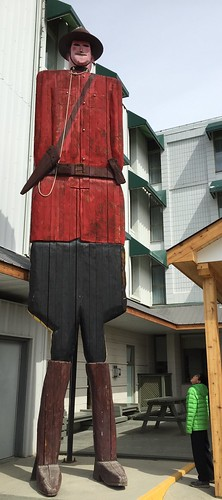 Folk art Mountie outside High Country Inn, Whitehorse.