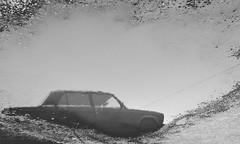 2496 (sul gm) Tags: auto blackandwhite bw espaa reflection water car spain agua eau ground bn coche reflejo charco