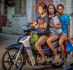 Three women (and an infant) on a motorbike