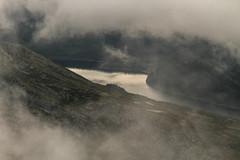 The Earth has silver eyes (Animusanima) Tags: norway europe mountain trip hike hiking lake altitude alpinelandscape landscape clouds mist summer august scandinavia neutralcolours awe outdoor adventure hardangervidda nationalpark