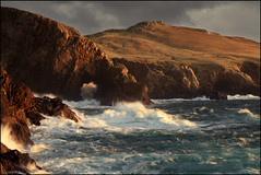 Sea Arch Strathy Point (angus clyne) Tags: road travel blue light sea cliff cloud sun lighthouse white storm west bird art fall grass rain rock canon dark lens point island drive coast scotland fly highlands arch nest time angus path walk tide north deep scottish wave spray filter photograph lee splash setting sutherland clyne strathy