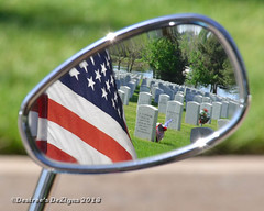 Reflecting on the Fallen (Desiree Banka) Tags: red usa reflection cemetery grave freedom mirror colorado flag headstone tombstone patriotic flags fourthofjuly motorcycle soldiers desiree restingplace july4th 4thofjuly patriotism memorialday redwhiteblue gravesite flagday usflag banka starsstripes usflags dezigns fortlogannationalcemetery desireebanka desireesdezigns wwwdesireesdezignscom