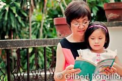 Belen & Gabby (Gilbert Rondilla) Tags: old city urban woman home senior girl smile smiling female happy reading book healthy grandmother vibrant philippines capital praying daughter happiness grand national elderly getty bible filipino pinay filipina jolly joyful region citizen oldage pinoy gettyimages prayerful gilbertrondilla gilbertrondillaphotography gettyimagescollection