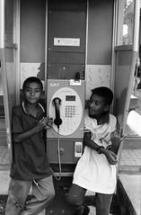 * (Sakulchai Sikitikul) Tags: life street leica bw film children kodak telephone trix ernst summicron 400 f2 ttl m6 wetzlar 085 leitz collapsible 5cm
