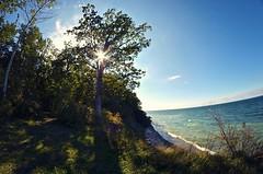 Bluff (kroess.photo.) Tags: shadow sun lake ontario tree fall nature lens angle fort walk wide niagara flare