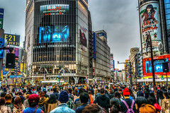 Shibuya Crossing in Tokyo (jkuphotos) Tags: street people signs electric japan japanese tokyo crossing crowd shibuya scene pedestrians scramble crowded jamesudall
