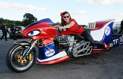 Holly_9836 (Fast an' Bulbous) Tags: top fuel bike motorcycle eurol sharkattack biker chick babe girl woman pinup model long brunette hair tight leather pvc leggings jeans red shoes high heels stilettos drag race strip track pits santa pod england eurofinals people outdoor pose nitro