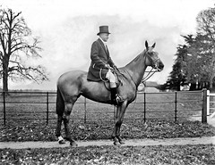 Mr. Frank Green, Treasurers House, York, on horse. (National Library of Ireland on The Commons) Tags: ahpoole arthurhenripoole poolecollection glassnegative nationallibraryofireland mrfrankgreen treasurershouse york england man horse saddle fence industrialist tophat franciswilliamgreen ridingcrop