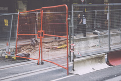 Fence (JacksonSwaby) Tags: fence barrier gate city metal tram line road path pavement shop shopfront people sign post