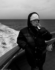Champagne, best served cold. (Neil. Moralee) Tags: neilmoralee norway2016neilmoraleenikond7100 champaggne cold arctic winter spitsbergen sea ocean ship passage drink champagne wine woman coat hat freeze alcohol black white bw mono monochrome neil moralee nikon d7100 18300mm zoom female lady wrpped up sailing gloves thermal