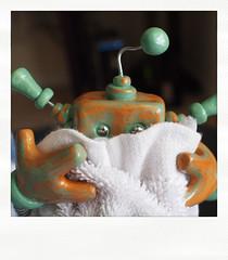 Sneak Peek: shy little robot hides behind blankie (HerArtSheLoves) Tags: fiction sculpture green bronze polaroid robot mixed wire media handmade ooak peak shy science clay blanket fi hiding antenna teaser sci geeky coiled sneak polymer poladroid