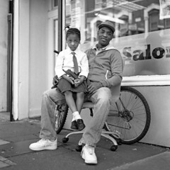 Next to barbershop (ted.kozak) Tags: family portrait man 6x6 girl mediumformat square sitting hairsalon selfdeveloped 100iso kozak bronicasqa shanghaigp3 zenzanonps80mmf28 tedkozak tadaskazakevicius wwwtedkozakcom tadaskazakeviciusportfolio