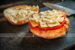 Lunch: Tomato & Cheese On An Onion Bun (marysmyth (NOLA 13) ) Tags: food kitchen cheese bread lunch tomatoes knife fresh onion cheddar bun mayonnaise gobsofmayo