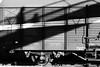 Trainspotting (CheapskateCigarettes) Tags: blackandwhite bw blackwhite shadows sony trains greece trainstation drama α700 snapseed