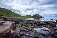 The surreal UNESCO world heritage interlocking basalt columns, Giant's Causeway, Northern Ireland (Maria_Globetrotter) Tags: world uk ireland sea seascape heritage tourism water beautiful wow wonderful out wonder landscape this coast site cool nice fantastic perfect long exposure day angle natural very cloudy awesome united famous north wide kingdom landmark super visit irland atlantic most le mysterious giants lovely activity typical northern incredible volcanic breathtaking causeway irlanda bushmills irlande phenomenon phenomenal ire img8907 vrldsarv mariaglobetrotter