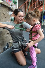 "Rock climbing guide Rachel secures BELL Participant Sydney so she can start her climb. • <a style=""font-size:0.8em;"" href=""http://www.flickr.com/photos/29389111@N07/9544577314/"" target=""_blank"">View on Flickr</a>"