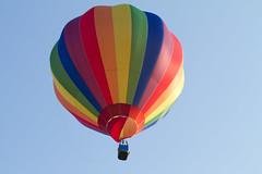 Rainbow Hot Air Balloon (Mukumbura) Tags: blue red sky orange hot green yellow flying rainbow colours basket air balloon flight indigo vivid peaceful grace liftoff hotairballoon colourful airborne graceful takeoff