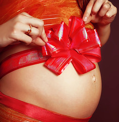 Pregnant girl with a red bow on her stomach (marozn) Tags: agift amother aribbonbow arm attractive baby belly birth body breasts caress close clothes fatherhood feminine finger hand hoping human life love maternalhealth medicine mother motherhood navel parents people pregnancy pregnant prepared stomach touch waiting waitingforthewhitewoman