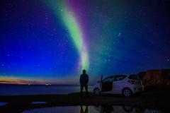 striking aurora (pixelthon) Tags: siglufjrur iceland aurora borealis night sea blue green colorful stars water travel outdoor wanderlust northern light lights nordlicht placetobe
