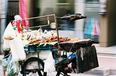 Bangkok, Sukhumvit soi 24 (jonasfj) Tags: nikonf3 f3 nikon 10525ais 105mm f25 ais kodak ektar kodakektar c41 colornegative film filmphotography street streetphotography bangkok sukhumvit sukhumvitsoi24 thailand asia foodstand chicken fish food streetfood thaifood thaistreetfood spicy pink motionblur