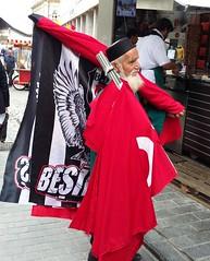 Old salesman in Istanbul (trendnewsagency) Tags: turkey istanbul old man salesman flag      people person eldest aged city oldman form figure shape fashion type