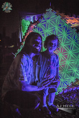 Mind, Body and Soul Festival 2016 (AJ Hge Photography) Tags: ajhgephotography ajhegephotography canon 60d event festival love florida centralflorida furtographer fun newsource article community talent maddoxranch lakeland mindbodysoul outdoor art night nighttime travel explore interesting kennyhenderson blacklight uv ultraviolet artist artwork structure sacredgeometry kodicore father son child kid glow smile baby people