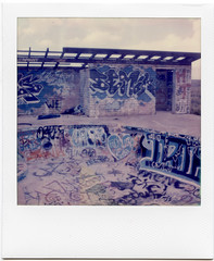 All the Words (T-Terror) Tags: polaroid autumnpolaroidweek2016 day5 roidweek2016 roidweek polaroidweek instant color roadtrip impossibleproject arizona roadside polaroidsx70 twogunsaz kamp abandoned graffiti pool building desert decay