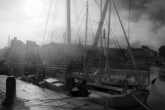"timeless B&W shot of Vieux Bassin (Old Harbour) in fierce October sunshine, Honfleur, Normandy, France (grumpybaldprof) Tags: honfleur normandy normandie france ""vieuxbassin"" ""oldharbour"" ""quaistecatherine"" ""quaiquarantaine"" quai ""quaistetienne"" ""stecatherine"" ""lalieutenance"" quarantaine water boats sails ships harbour historic old ancient monument picturesque restaurants bars town port colour lights reflection architecture buildings mooring sailing stone collombage halftimbered yachts carousel merrygoround reflections ""waterreflections ""wetreflections""funfair ""blackwhite"" ""blackandwhite"" monochrome bw hoteldeville quaistetienne tamron 16300 16300mm ""tamron16300mmf3563diiivcpzdb016"""