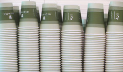Stack 'em up (Claire Wroe) Tags: paper cup coffee tea drink canteen work office cafe white cardboard green caffeine coop cooperative manchester repeat multiple pattern many