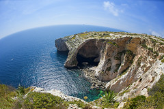 Blue Grotto Malta (Allard Schager) Tags: sea cliff distortion plant tourism nature boats island coast spring nikon rocks republic malta fisheye april coastline maltese lente eclectic eyecandy harsh mediterraneansea bold archipelago gettyimages 2012
