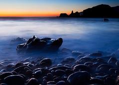 Rocks on Water (Eric_X) Tags: ocean california longexposure blue sunset red orange usa mist blur water yellow night rocks warm bigsur goldenhour