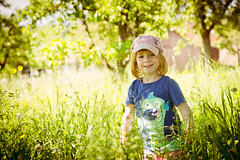 Country Girl II (whooosh.) Tags: summer sunlight tree nature girl field smiling backlight countryside kid spring outdoor meadow cap
