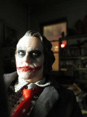 Heath Ledger Joker Sitting in the Shadows 9068 (Brechtbug) Tags: new york city nyc red portrait hot film mystery dark comics movie toy toys book weird dc costume blood comic sitting shadows with serious action tie battle disguise heath figure batman joker knight why gotham villain detective 2014 ledger so 05052014