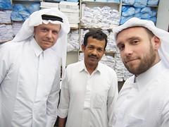 Buying the Thoub, (qatari dress) at Souq Waqef.