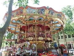 The Carousel in Nimes (vw4y) Tags: france carousel crocodile merrygoround nimes citycrest
