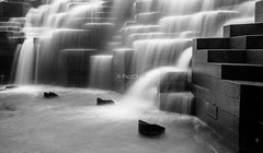 Aon Center waterfall (www.abhijitphotos.com) Tags: water waterfront blackandwhite bw mono monochrome longexposure silky smooth aoncenter flowing