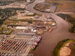 Air Shipment (nywheels) Tags: ship terminal water river grass viewfromabove vehicles ground structures trailers buildings